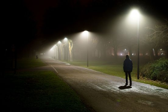 somber-teen-walks-alone-on-a-dark-path-the-overhead-floodlighting-of-streetlamps-and-the-suburban-setting-hint-at-a-deeper-significance-it-is-a-metaphor-maybe-4115-ee60d5d638f94beebee648